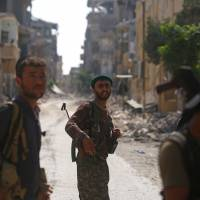 Islamic State fighters using human shields in Raqqa pockets as U.S.-backed forces take most of city