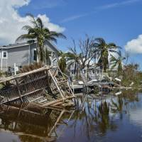 Damaged homes are seen near Marathon, Florida, Tuesday after Hurricane Irma. Florida is cleaning up and embarking on rebuilding from Hurricane Irma, one of the most destructive hurricanes in its history. | SCOTT CLAUSE / THE DAILY ADVERTISER / VIA AP