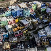 Destroyed homes sit surrounded by debris from Hurricane Maria in this aerial photograph taken above La Perla in San Juan, Puerto Rico, on Monday. | BLOOMBERG