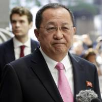 North Korean Foreign Minister Ri Yong Ho speaks outside the U.N. Plaza Hotel in New York on Monday. | AP