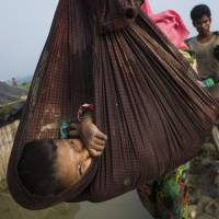 Crisis looms as nearly 125,000 refugees flood into Bangladesh
