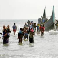 Religious strife risks fueling further Myanmar violence, Rohingya flight: think tanks