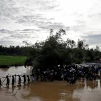Rohingya villagers in Myanmar beg for safe passage out after Buddhists allegedly threaten to kill them all