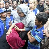 Bangladeshi Prime Minister Sheikh Hasina meets with Rohingya Muslims at the Kutupalong refugee camp, near the border town of Ukhia, Bangladesh, Tuesday. Hasina visited the struggling refugee camp that has absorbed some of the hundreds of thousands of Rohingya who fled recent violence in Myanmar, a crisis she said left her speechless. | AP