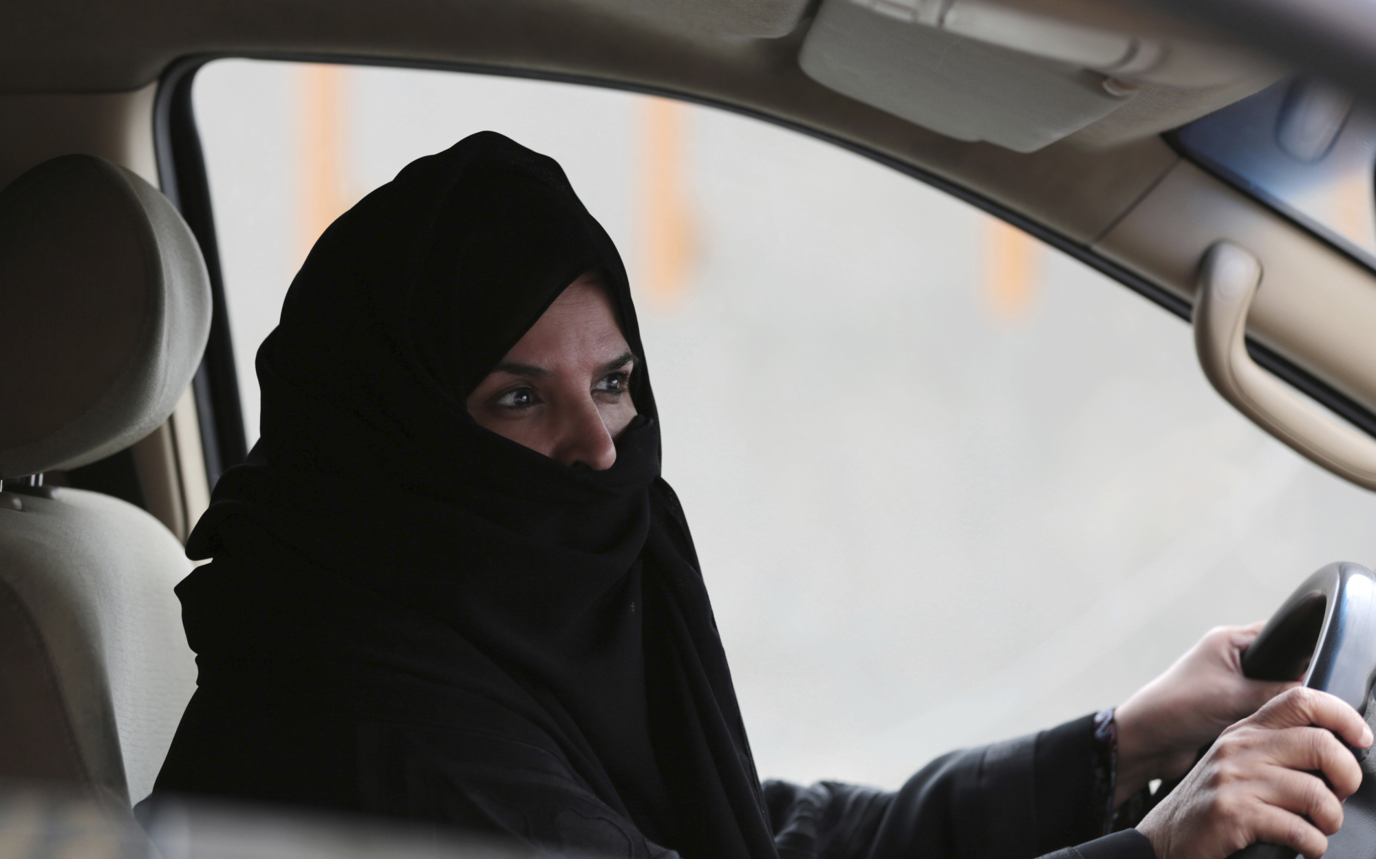 A Saudi Arabian woman drives on a Riyadh highway as part of a campaign to defy the ban on women driving in March 2014.   AP