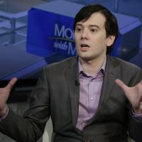 Former pharmaceutical CEO Martin Shkreli speaks during an interview by Maria Bartiromo during her 'Mornings with Maria Bartiromo' program on the Fox Business Network in New York in August. Shkreli's lawyer says his client's caustic online rants shouldn't be taken so seriously. The attorney for the convicted ex-biotech CEO argued in court papers filed Tuesday that Shkreli's recent offer to pay a $5,000 bounty for a lock of Hillary Clinton's hair falls under the category of 'political satire or strained humor.' | AP