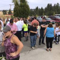 Parents gather in the parking lot behind Freeman High School in Rockford, Washington, to wait for their kids, after a deadly shooting at the high school Wednesday. | DAN PELLE / THE SPOKESMAN-REVIEW / VIA AP