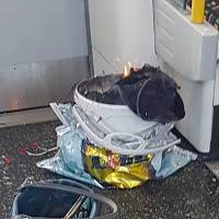 A handout picture obtained from the twitter user @sylvainpennec shows a white container burning inside a London Underground tube carriage at Parsons Green underground tube station on Sept. 157. More than 20 passengers were injured, some suffering severe burns, in an early morning explosion on a London Underground train in what police described as a 'terrorist incident,' the fifth attack in six months in Britain. | ADRIAN DENNIS / AFP PHOTO AND @SYLVAINPENNEC / VIA AFP-JIJI