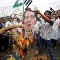 People burn an effigy of Aung San Suu Kyi in Kolkata on Monday over what protesters called the killings of Rohingya in Myanmar. | REUTERS