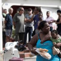 Shades of Katrina as Irma lays bare racial tensions on smashed St. Martin