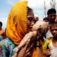 'Worst-case scenario' of full-on flight feared as Myanmar military accused of torching Rohingya villages