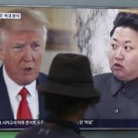 A man watches a TV screen showing U.S. President Donald Trump and North Korean leader Kim Jong Un during a news program at Seoul Train Station in the South Korean capital on Aug. 10. | AP