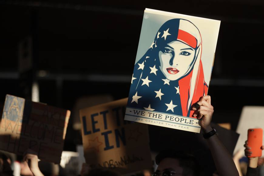 Trump travel ban seen on more solid ground as top court drops hearing but critics say Muslims still target