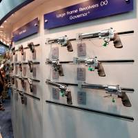 Gun enthusiasts look over Smith & Wesson guns at the National Rifle Association's annual meetings and exhibits show in Louisville, Kentucky, in May 2016.   REUTERS
