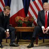 President Donald Trump jokes with French President Emmanuel Macron during a meeting at the Palace Hotel during the United Nations General Assembly Monday in New York. | AP