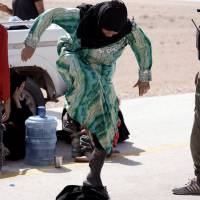 American Islamic State fighter surrenders in Syria to U.S.-backed forces