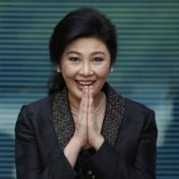Former Thai Prime Minister Yingluck Shinawatra arrives at the Supreme Court to make her final statements in a trial on a charge of criminal negligence in Bangkok on Aug. 1. | AP