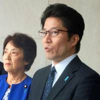 Takuya Yokota, whose sister, Megumi Yokota, was abducted by North Korea in 1977, speaks to reporters in Washington on Wednesday. Yokota and former abduction minister Eriko Yamatani (left) met with U.S. officials and lawmakers to discuss the matter. | KYODO