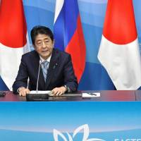 Prime Minister Shinzo Abe and Russian President Vladimir Putin hold a joint news conference Thursday in Vladivostok, Russia, after their summit meeting. | KYODO