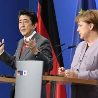 Prime Minister Shinzo Abe and German Chancellor Angela Merkel agreed on a tougher sanction against North Korea at a teleconference held Tuesday. | KYODO