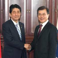 Abe, Moon agree to push for stronger pressure on North Korea through new sanctions