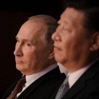 Russian President Vladimir Putin and Chinese President Xi Jinping watch a concert in Xiamen, China, on Sunday. | REUTERS