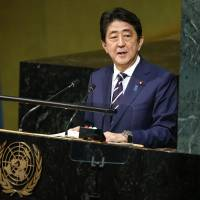Prime Minister Shinzo Abe addresses the United Nations General Assembly at U.N. headquarters in New York Wednesday. | AP