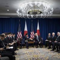 Prime Minister Shinzo Abe and U.S. President Donald Trump (center, right) start their meeting at the Palace Hotel during the 72nd United Nations General Assembly Thursday in New York City. | AFP-JIJI