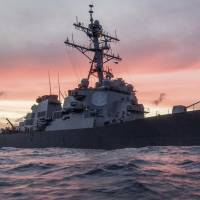 The U.S. Navy destroyer USS John S. McCain conducts a patrol in the South China Sea in January. | REUTERS
