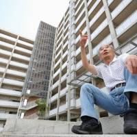 Toshiji Sato, who lives in government-run housing provided for those displaced by the March 2011 disasters, talks Sunday about the difficult living conditions he faces in Sendai. | KYODO
