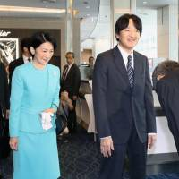 Prince Akishino and his wife, Princess Kiko, are seen at Tokyo's Haneda airport on Monday before departing for their 10-day trip to Chile. | KYODO