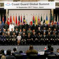 Heads of coast guard organizations from over 30 nations attend a family photo session during the Coast Guard Global Summit, jointly hosted by the Japan Coast Guard and Tokyo-based Nippon Foundation, in Tokyo on Thursday. | REUTERS