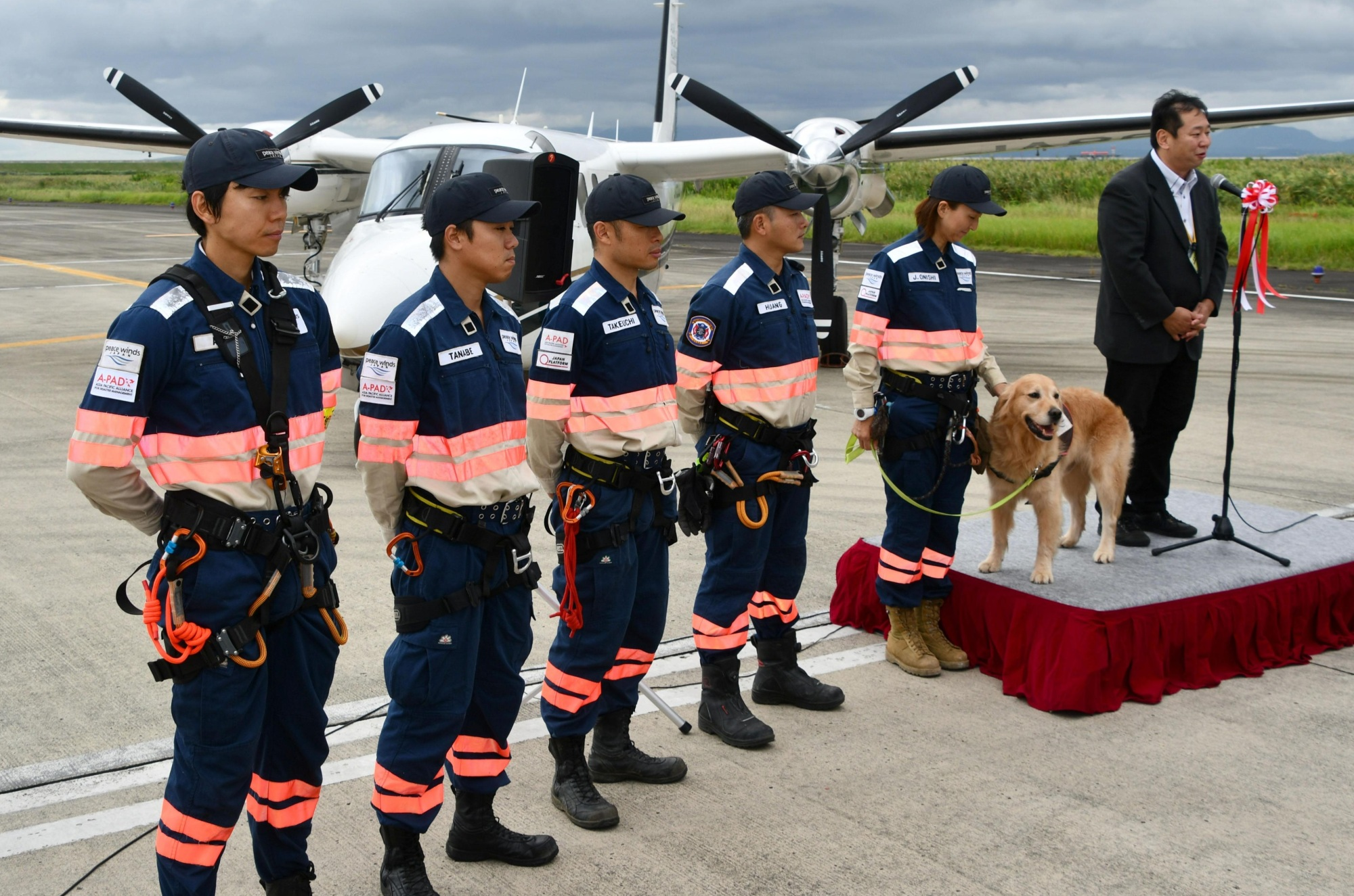 Members of a team of 'flying doctors,' which provides emergency relief in disaster zones, attend a ceremony at Saga airport on Thursday where a special aircraft was unveiled. | KYODO