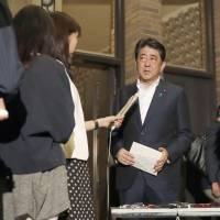 Prime Minister Shinzo Abe speaks to reporters late Sunday following telephone talks with U.S. President Donald Trump regarding North Korea's latest nuclear test. | KYODO