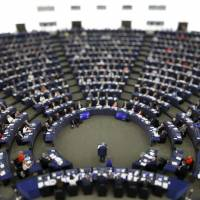 In this image made with a tilt-shift lens, European Commission President Jean-Claude Juncker addresses the members of the European Parliament in Strasbourg, eastern France, to outline his reform plans for the European Union in the so-called State of the Union debate Wednesday. | AP