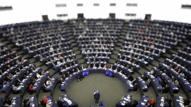 In this image made with a tilt-shift lens, European Commission President Jean-Claude Juncker addresses the members of the European Parliament in Strasbourg, eastern France, to outline his reform plans for the European Union in the so-called State of the Union debate Wednesday.