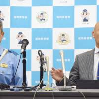 Fukuoka Prefectural Police officials hold a news conference Friday to announce the arrest of six members of the Kudo-kai crime syndicate over a 2011 shooting in Kitakyushu. | KYODO