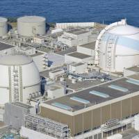 Kyushu Electric Power Co. aims to bring the No. 4 unit (left) at its Genkai nuclear power plant in Saga Prefecture back online in early March. | KYODO