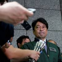 Defense Minister Itsunori Onodera takes questions from reporters last week at his ministry. He has asked William Hagerty, the new U.S. ambassador to Japan, to heed Japanese citizens' concerns over the hosting of U.S. bases. | REUTERS