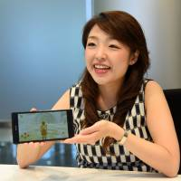 Ayako Shimizu, president of Hikari Lab, talks about the SPARX role-playing video game that her company introduced to Japan, during an interview in Tokyo earlier this month. | SATOKO KAWASAKI