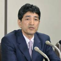 Former Aum Shinrikyo spokesman Fumihiro Joyu, now head of offshoot Hikari no Wa (Circle of Light), holds a news conference in the Tokyo District Court on Monday after the court ruled that state surveillance on the group was no longer necessary. | KYODO