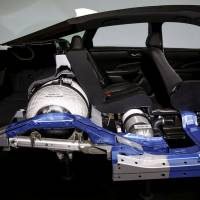 The internal workings of a Clarity, Honda's first mass-market fuel cell vehicle, is displayed at the carmaker's headquarters in Tokyo in March 2016. | REUTERS