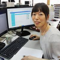 Risa Urata, who has a developmental disorder, explains a software program developed by her company, Okushin System, that monitors early symptoms of mental health issues, on Aug. 4 in Osaka. | KYODO