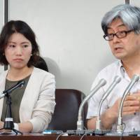 Lawyers Ayane Odagawa and Shogo Watanabe, members of Japan Lawyers Network for Refugees, speak at a news conference Tuesday at the Tokyo District Court. | DAISUKE KIKUCHI