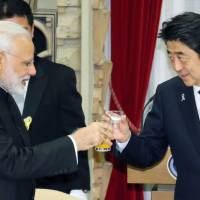 Prime Minister Shinzo Abe and his Indian counterpart, Narendra Modi (left), raise their glasses during a dinner party at Abe's official residence in Tokyo in November 2016. KYODO