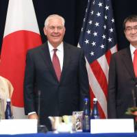 Foreign Minister Taro Kono (right), U.S. Secretary of State Rex Tillerson (center) and Indian External Affairs Minister Sushma Swaraj pose for photos in New York on Monday. POOL / VIA KYODO
