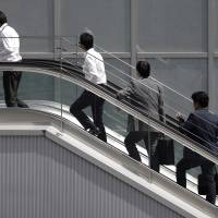 About one third of people who started to work just after graduating from university in March 2014 quit their jobs within three years. | BLOOMBERG