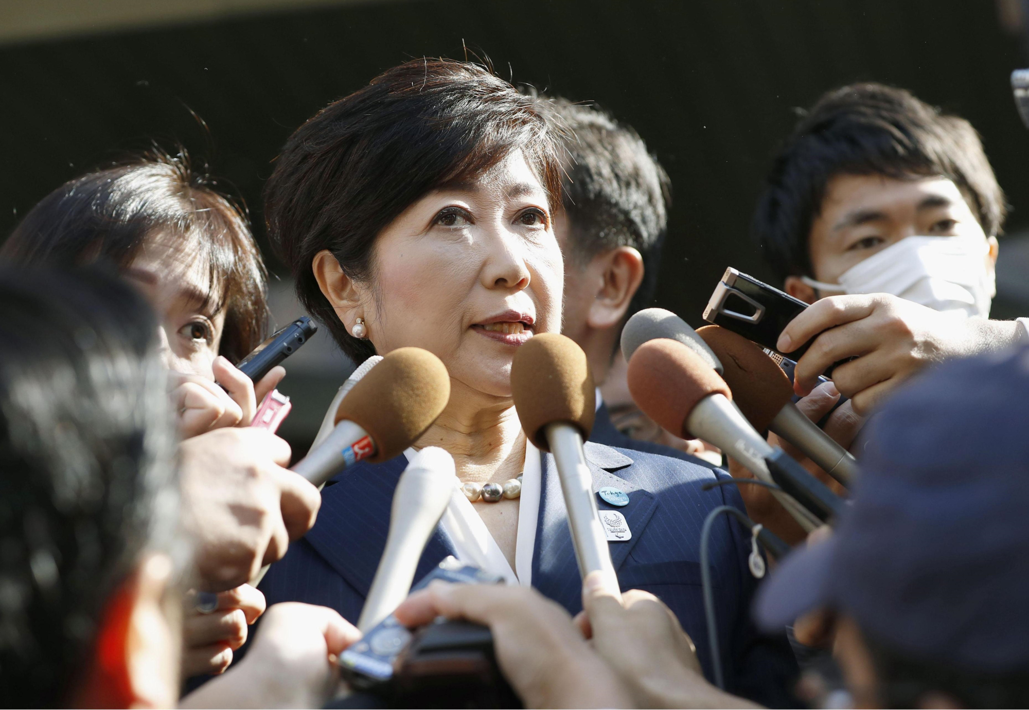 Tokyo Gov. Yuriko Koike speaks to reporters after meeting with Democratic Party leader Seiji Maehara in Tokyo on Friday. | KYODO
