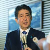Prime Minister Shinzo Abe favors a constitutional revision to formalize the existence of the SDF. | AFP-JIJI