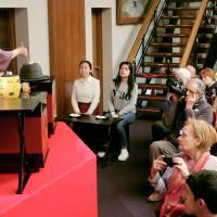 Tourists watch a tea ceremony in Kyoto, one of the most popular destinations in Japan. | KYODO